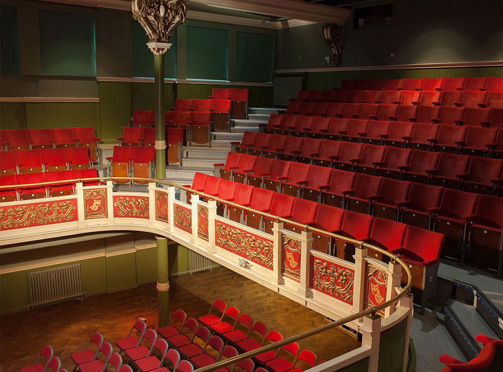 Image of The Y Theatre auditorium, with seating in the stalls and the balcony